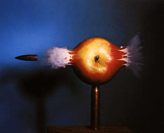Bullet through apple caught with high speed camera