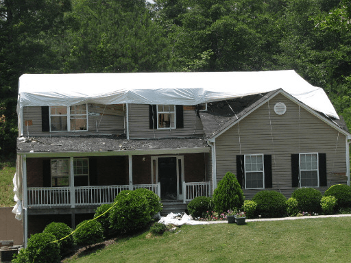 Shrink wrap application damaged house