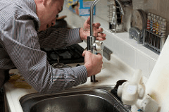 Man performing plumbing services