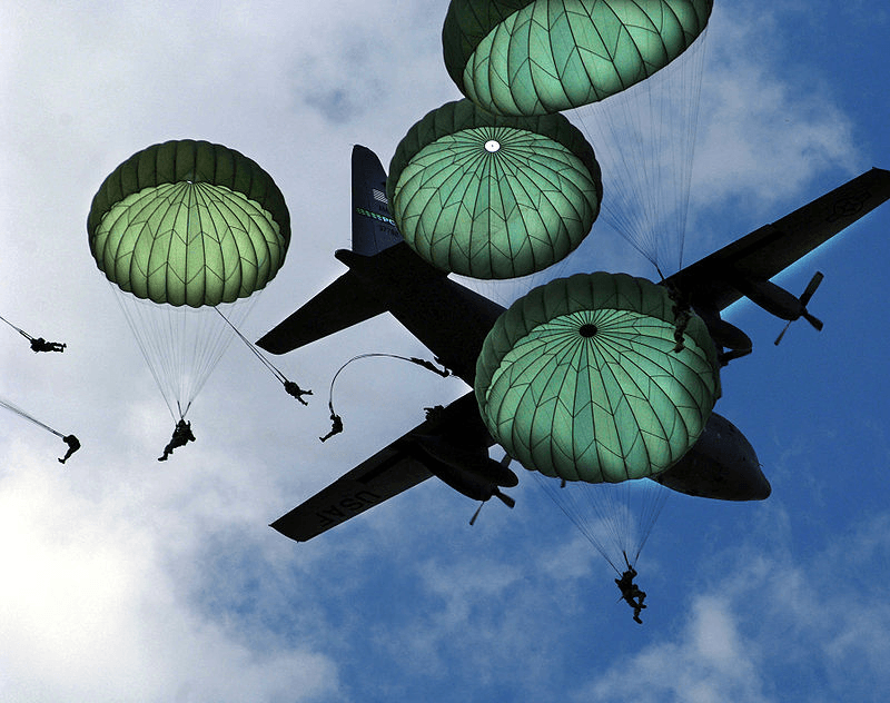 Soldiers parahuting from a C-130