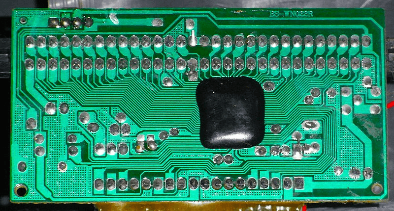 Chip on board covered with dark epoxy