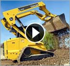 Excavator Spills Dirt on Tracked Diggers